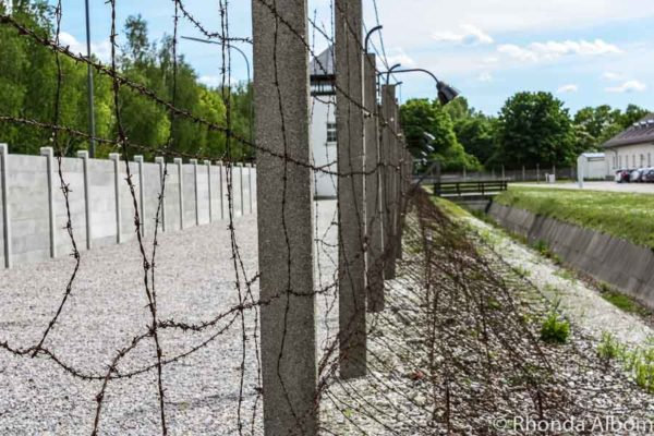Fence and watch tower surrounding Dachau Concentration Camp in Dachau Germany