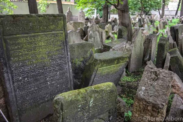 Hebrew writing on an Grave stones in the Old Jewish Quarter in Prague Czech Republic