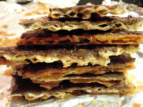 A stack of chocolate toffee matzo.