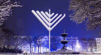 Snow covered giant menorah in Victoria Gardens on the Old Steine, Brighton, East Sussex, England.