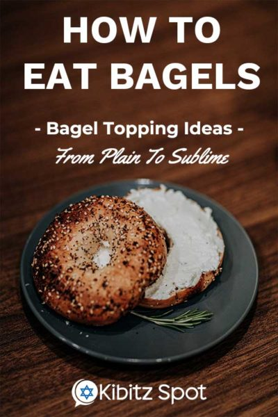 An everything bagel with a shmear of cream cheese on a plate