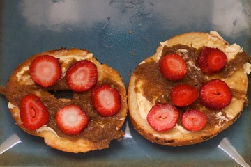 Apple butter and strawberries on a bagel