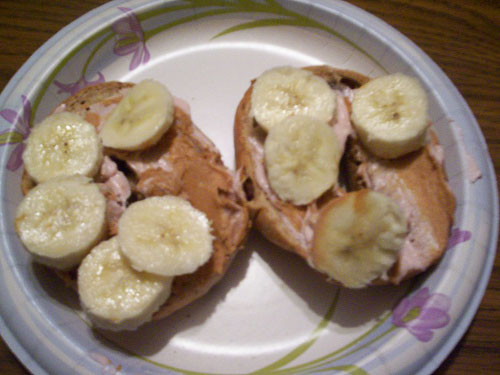 Bagel topped with peanut butter and banana
