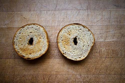Toasted plain bagel cut in half