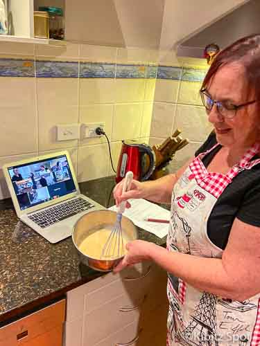 Mixing the kaya ingredients to make a coconut jam while the live class is on the computer in the background