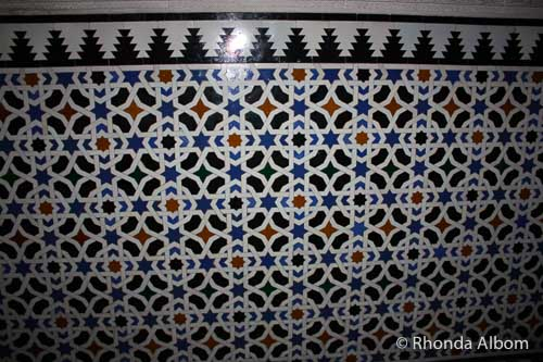A repeating tile wall pattern containing the Star of David in the Alcazar in Seville Spain