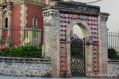 A gate with Jewish star patterns in the tiles in front of a house in Comillas Spain