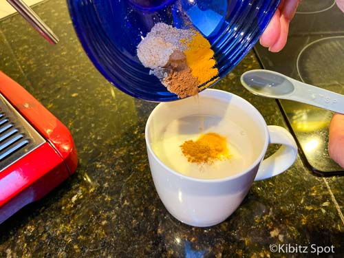 Adding spices to create a latte