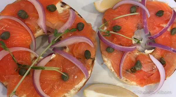 Lox and bagels sandwich with capers and onion as part of our Yom Kippur break fast menu