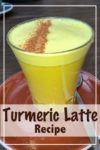 A freshly made turmeric latte with a sprinkle of cinnamon on top