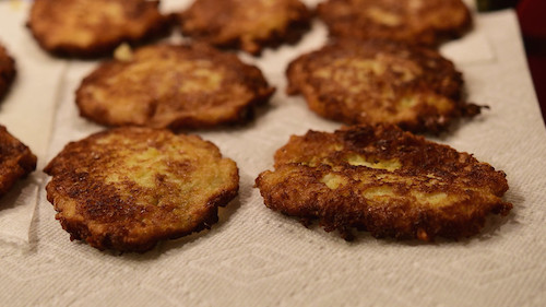 Freshly fried potato pancakes on paper towels