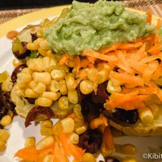 Mexican potato dinner with corn, avocado, black beans, olives, and more great baked potato bar ideas