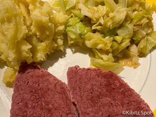 Corned beef, fried cabbage and mashed potato on a plate