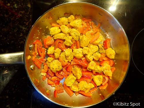 Fish, peppers, and spices frying in the pan