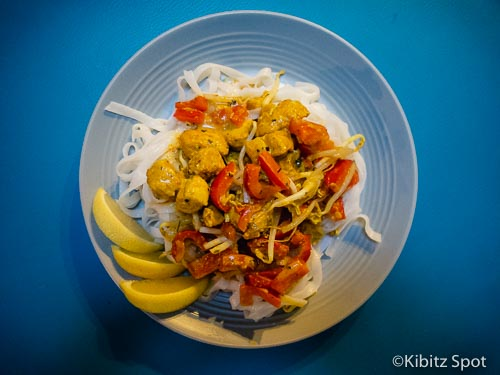 Malaysian fish curry served on a bed of rice noodles