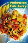 Malaysian fish curry on a bed of rice noodles with lemon slice garnish