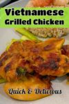 Vietnamese grilled chicken with rice, green vegetables and lime wedges
