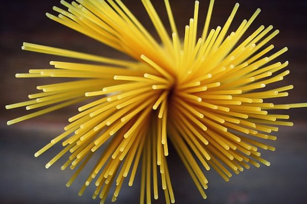 dry spaghetti in an expanded bunch