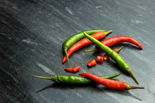 Red and green hot chili peppers chopped for fermented hot chilli sauce