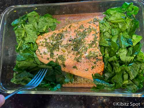 Spinach added to pan with salmon