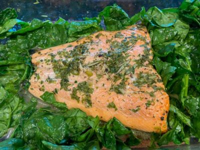 Baked salmon and spinach in a pan