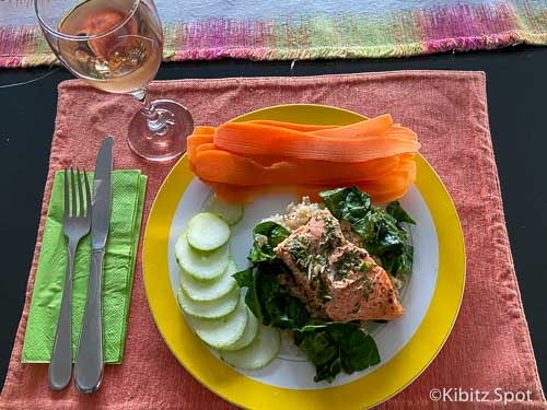 Baked salmon and Spinach with a glass of wine.